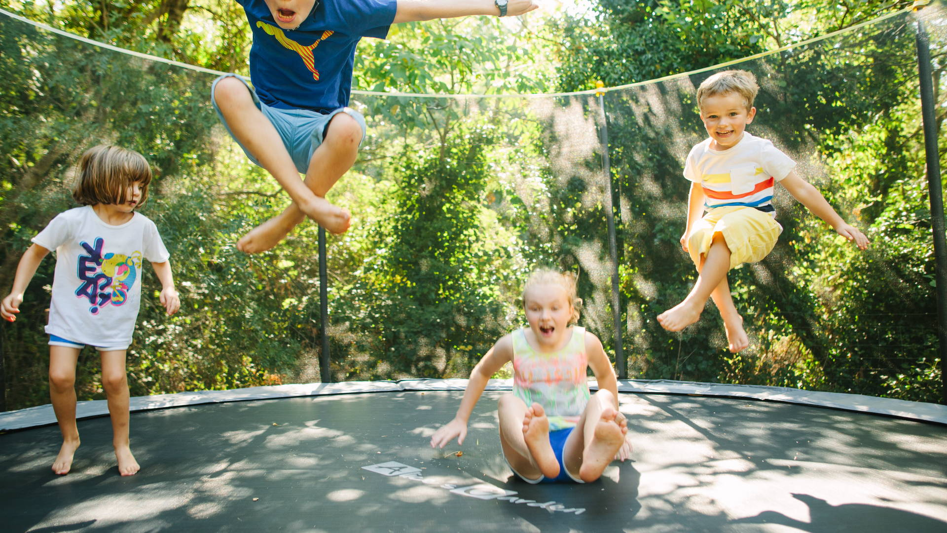 Children playing trampoline in a family friendly gites in France